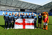 England walking footballers on the pitch with an England flag before the world's first Walking Football International match between England and Italy at the American Express Community Stadium, Brighton and Hove, England on 13 May 2018. Picture by Graham Hunt.