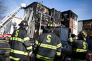 (Cambridge, MA - March 31, 2007) Fire Fighters from Cambridge, Boston and Somerville fight a three alarm fire on Seventh Street early Saturday Morning. .Photo by Justin Ide
