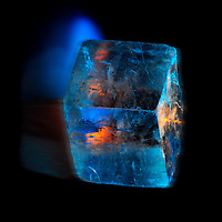 More fire and ice through space.  A selenite cube about to burst in to flame as if speeding through space and time