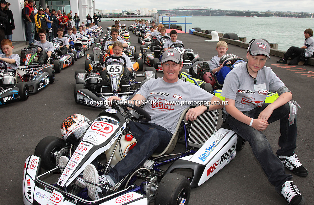 New Zealand Motorsport legend Scott Dixon with Can Teen Member Wayne Cherry and carting enthusiasts during a photo call at the Hilton Hotel after signing a sponsorship deal with Repco and Canteen. Auckland, Tuesday 24 September 2008. Photo: Andrew Cornaga/PHOTOSPORT