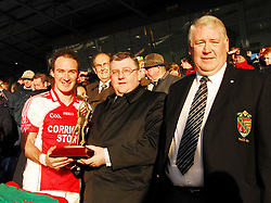Ballintubber's Alan Dillon accecpts the Man of the Match  award from Pat Jennings Manager of the TF...Pic Conor McKeown