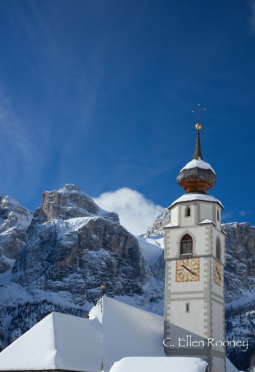 A church in Colfosco in Badia in front of the Sella Massiff mountain range in the Dolomites in the South Tyrol, Italy