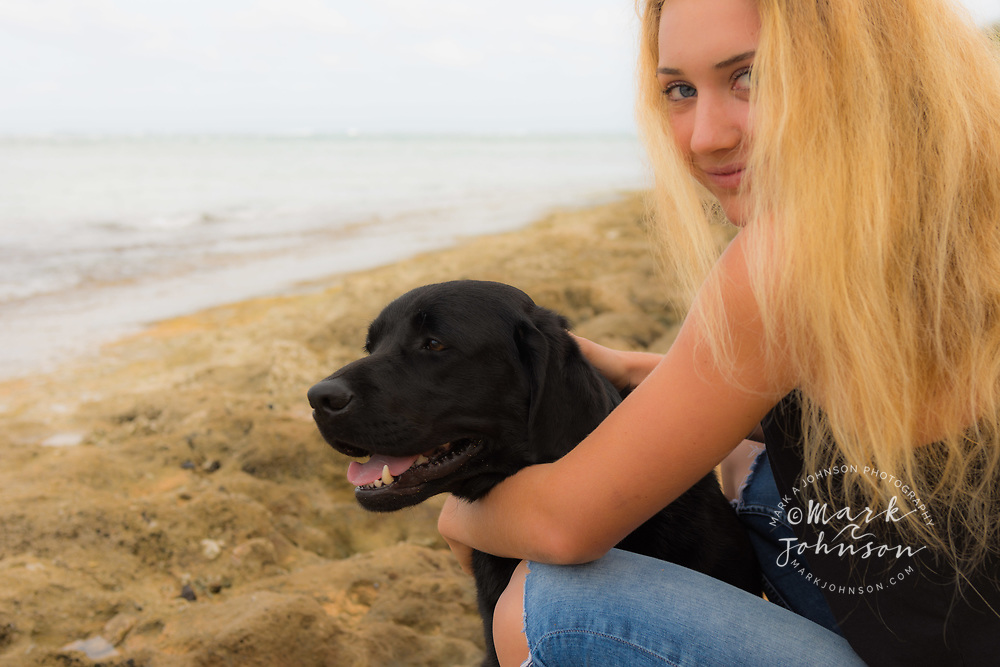 14 year old teenage girl & her black Labrador pet dog on the beach people *****Property Release available ****Model Release available