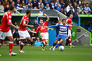 Jim O'Brien (8) of Barnsley challenges Jem Karacan (4) of Reading during the Npower Championship match between Reading and Barnsley on Saturday 25th September 2010 at the Madejski Stadium, Reading, UK. (Photo by Andrew Tobin/Focus Images)