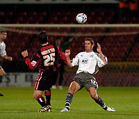 Photo: Leigh Quinnell.<br /> AFC Bournemouth v Bristol City. Coca Cola League 1. 26/09/2006. Bournemouths Darren Anderton lofts the ball over Bristol Citys Alex Russell.