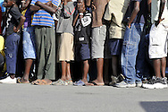 Port-au-Prince, Haiti.  Young Haitian children wait in line outside a feeding center in Port-au-Prince, Haiti on Saturday, January 30, 2010. A massive 7.0 earthquake struck the Caribbean island nation on January 12th., killing upwards of 200,000 people.