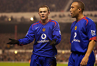 Photo: Daniel Hambury.<br />Arsenal v Manchester United. The Barclays Premiership.<br />03/01/2006.<br />United's Wayne Rooney appelas after being booked.