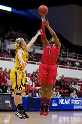 March 20, 2010; Stanford, CA, USA;  Rutgers Scarlet Knights guard Khadijah Rushdan (1) shoots over Iowa Hawkeyes guard Kamille Wahlin (2) during the first half in the first round of the 2010 NCAA womens basketball tournament at Maples Pavilion.  Iowa defeated Rutgers 70-63.