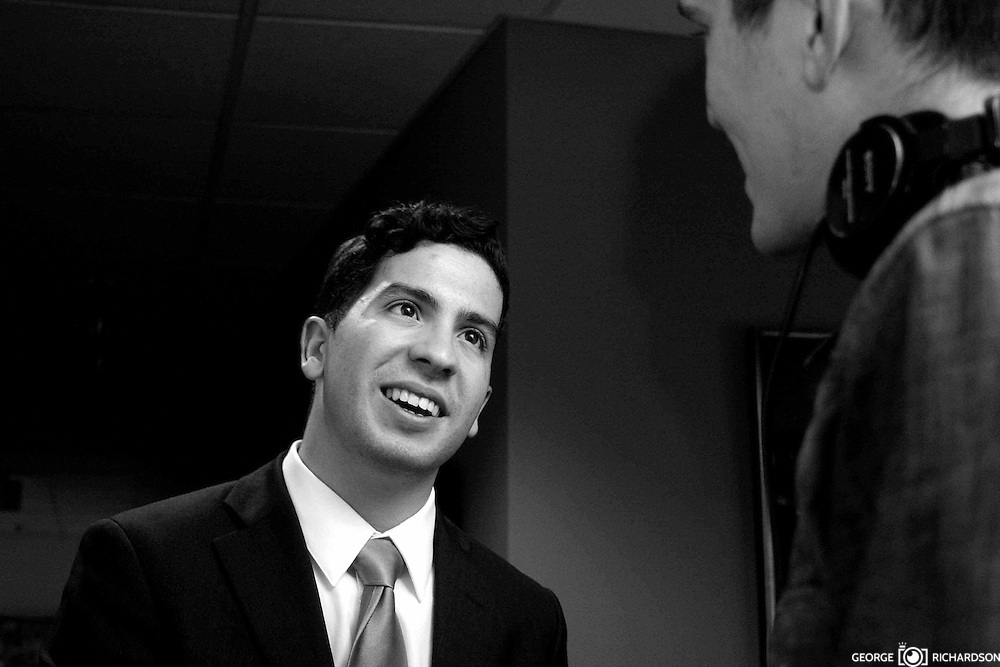 Vargas smiles while chatting with Simon Rios.<br />