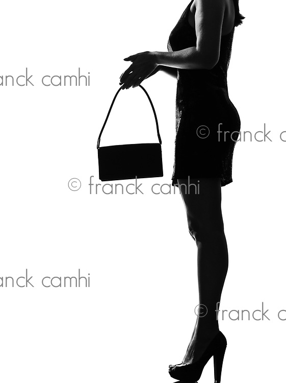 stylish sexy silhouette caucasian beautiful woman legs close=up details profile standing waiting on studio isolated white background