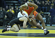 January 07, 2011: Iowa's Nick Moore grabs Oklahoma State's Albert White during the 157-pound bout in the NCAA wrestling dual between the Oklahoma State Cowboys and the Iowa Hawkeyes at Carver-Hawkeye Arena in Iowa City, Iowa on Saturday, January 7, 2012. White won 7-4.