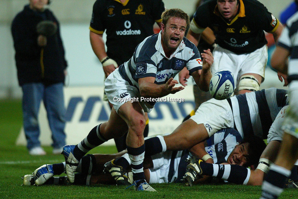 Auckland's captain Xavier Rush passes out the scrum ball during Lion's 27-21 win over Auckland. Wellington Lions vs Auckland at the Westpac Stadium, Wellington, New Zealand. NPC Div 1 11 September 2004<br /> Photo: Marty Melville/Photosport