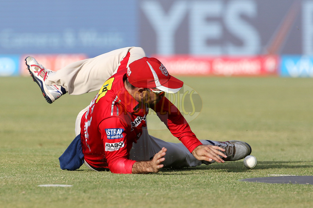 Glenn Maxwell of Kings XI Punjab dives to stop the ball during match 26 of the Vivo 2017 Indian Premier League between the Gujarat Lions and the Kings XI Punjab held at the Saurashtra Cricket Association Stadium in Rajkot, India on the 23rd April 2017<br /> <br /> Photo by Vipin Pawar - Sportzpics - IPL