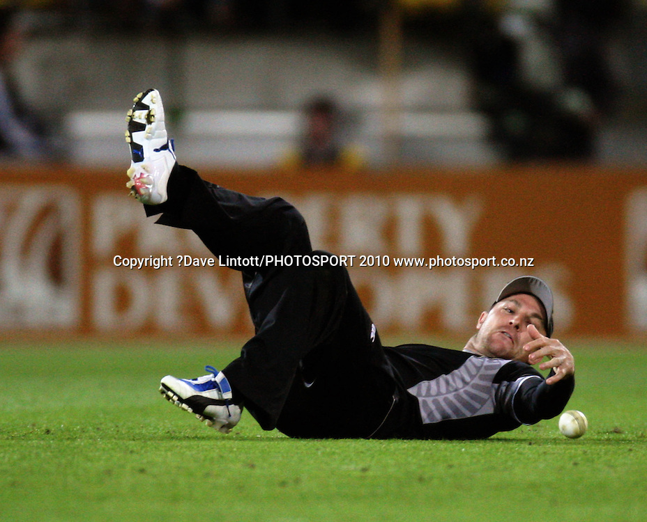 NZ's Brendon McCullum fumbles the ball while fielding.<br /> Fifth Chappell-Hadlee Trophy one-day international cricket match - New Zealand v Australia at Westpac Stadium, Wellington. Saturday, 13 March 2010. Photo: Dave Lintott/PHOTOSPORT