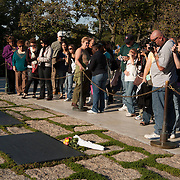 Visitors at the gravesite of U.S. President John F. Kennedy and his wife First Lady Jacqueline Bouvier Kennedy, in Arlington National Cemetery, in Arlington County, Virginia. The cemetery is directly across the Potomac River and the Lincoln Memorial. U.S. war casualties, and deceased veterans, of the nation's conflicts beginning with the American Civil War, are interred in this cemetery.  <br />