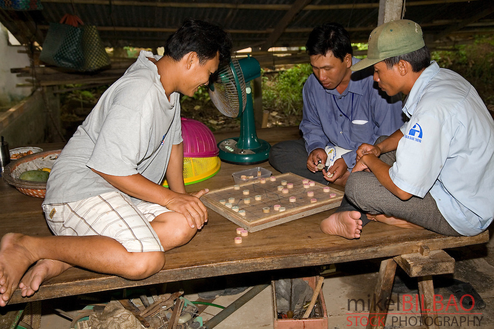 young people playing a board game.<br />