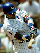 The Cubs' Sammy Sosa belts a solo home run off Philadelphia's Randy Wolf in the second inning at Wrigley Field on August 1, 2004.