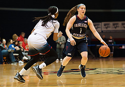 March 6 2016: Fairleigh Dickinson Lady Knights guard Madelynn Comly (1) brings the ball up court against Robert Morris Colonials forward Jocelynne Jones (1) during the first half in the NCAA Women's Basketball game between the Fairleigh Dickinson Lady Knights and the Robert Morris Colonials at the Charles L. Sewall Center in Moon Township, Pennsylvania (Photo by Justin Berl)