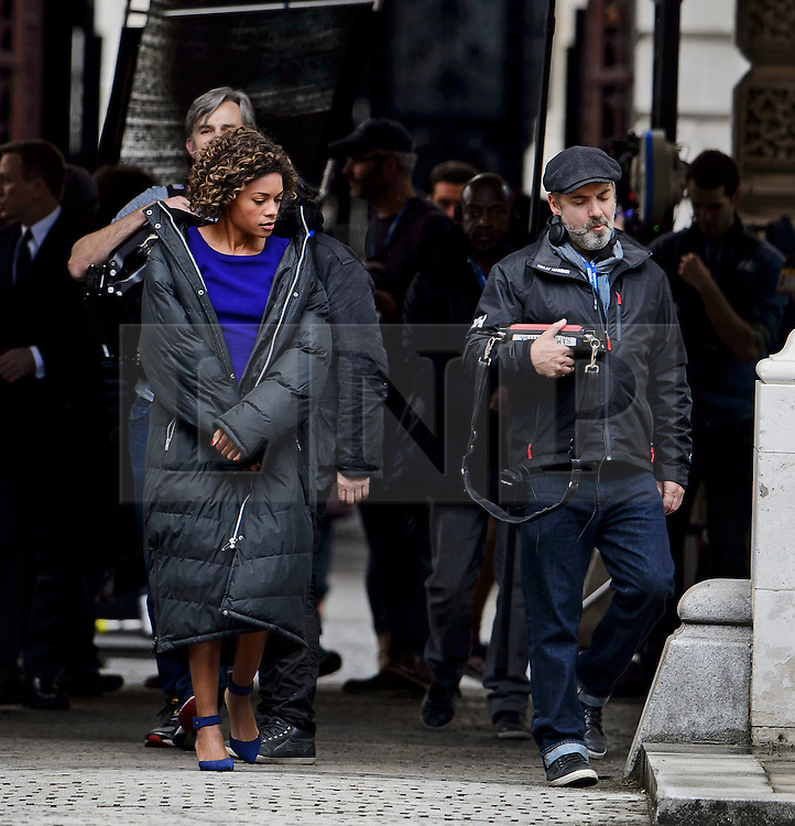 "© Licensed to London News Pictures. 30/05/2015. London, UK. Actress Naomie Harris and director Sam Mendes (right). Filming for the new James Bond film ""Spector"" with Daniel Craig and Naomie Harris at the courtyard of the UK Government Treasury building in Westminster, London . Photo credit: Ben Cawthra/LNP"