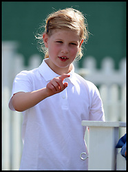 The Earl and Countess of Wessex  daughter Lady Louise Windsor playing on the remote control land rovers  at the Royal Windsor Horse Show. Windsor, United Kingdom. Wednesday, 14th May 2014. Picture by Andrew Parsons / i-Images