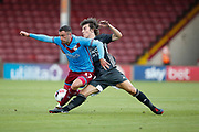 Calgary Soyuncu of Leicester City challenges Lee Novak Of Scunthorpe United during the Pre-Season Friendly match between Scunthorpe United and Leicester City at Glanford Park, Scunthorpe, England on 16 July 2019.
