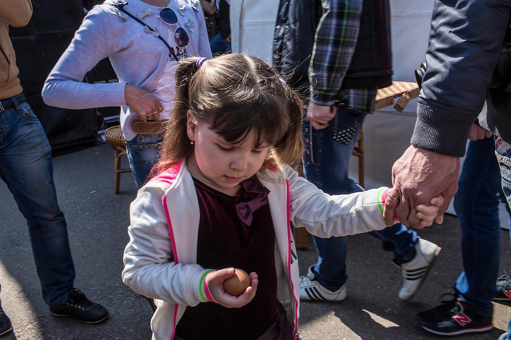 A girl holds an Easter egg on Orthodox Easter on Sunday, April 12, 2015 in Donetsk, Ukraine.