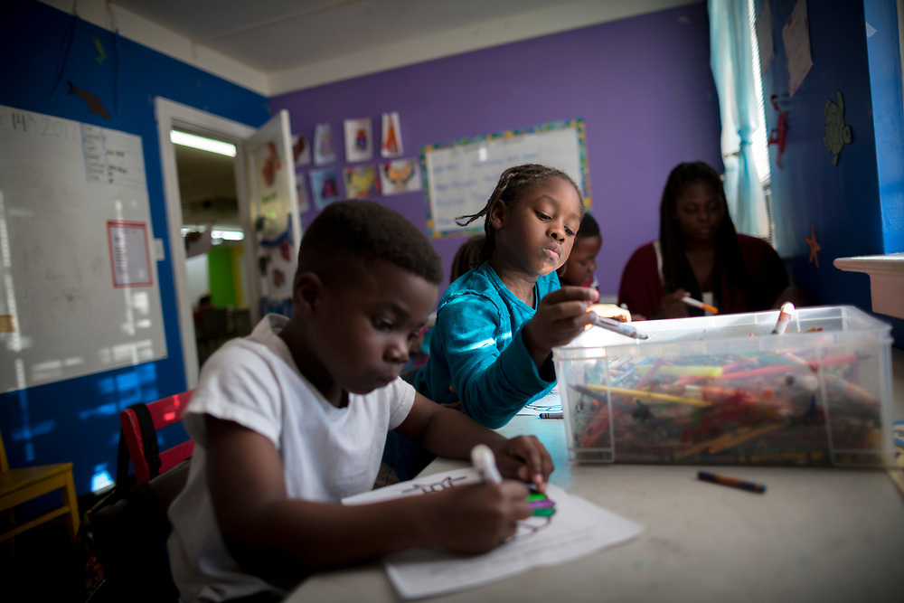 NOVEMBER, 16, 2017 - NORTH CHARLESTON, S.C.- Student Jaquan Sanders, left, and Xqden Hutchin, center, colors by numbers during a math class at the school in North Charleston, South Carolina. (BNG/Stephen B. Morton)