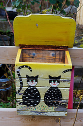 Painted wooden mailbox in village in Sweden