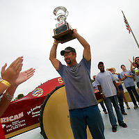 NAPLES, FL -- March 6, 2011 -- Pro Modified 4WD driver Eddie Chesser of The Rapture hoists his trophy after winning during the Swamp Buggy Races at the Florida Sports Park in Naples, Fla., on Sunday, March 6, 2011.  The races originated in the 1940's by bored hunters and draws thousands of fans three times a year to take in the buggies and jeep compete in the swamp. (Chip Litherland for ESPN the Magazine)