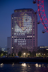 "@Licensed to London News Pictures 10/05/2016. Central London, UK. The National Deaf Children's Society (NDCS) projects 100 images of deaf babies onto the iconic Shell Centre Building on South Bank in Central London. The NDCS is celebrating 10 years of new-born hearing screening in England and launching a ""Right from the Start"" campaign for better quality early years support for families of deaf babies. NDCS is the leading charity dedicated to creating a world without barriers for deaf children and their families. Photo credit: Manu Palomeque/LNP"