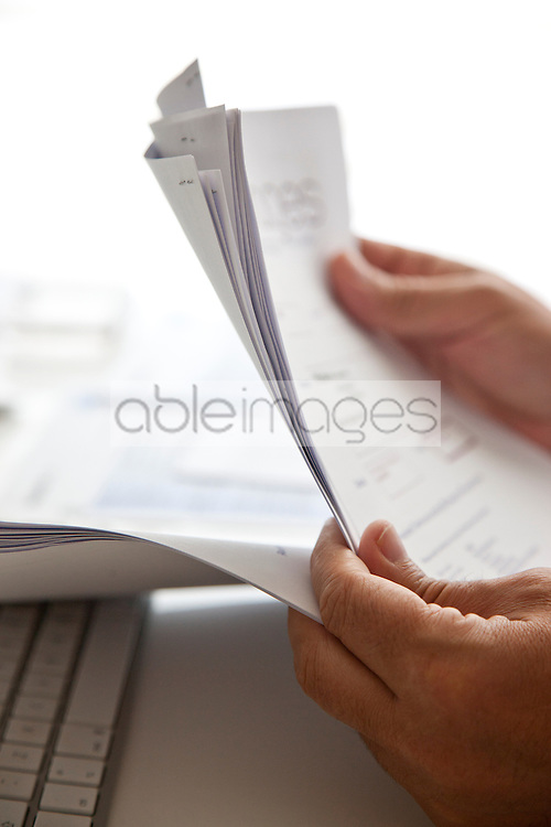 Man's Hands Sorting Out Bills and Documents