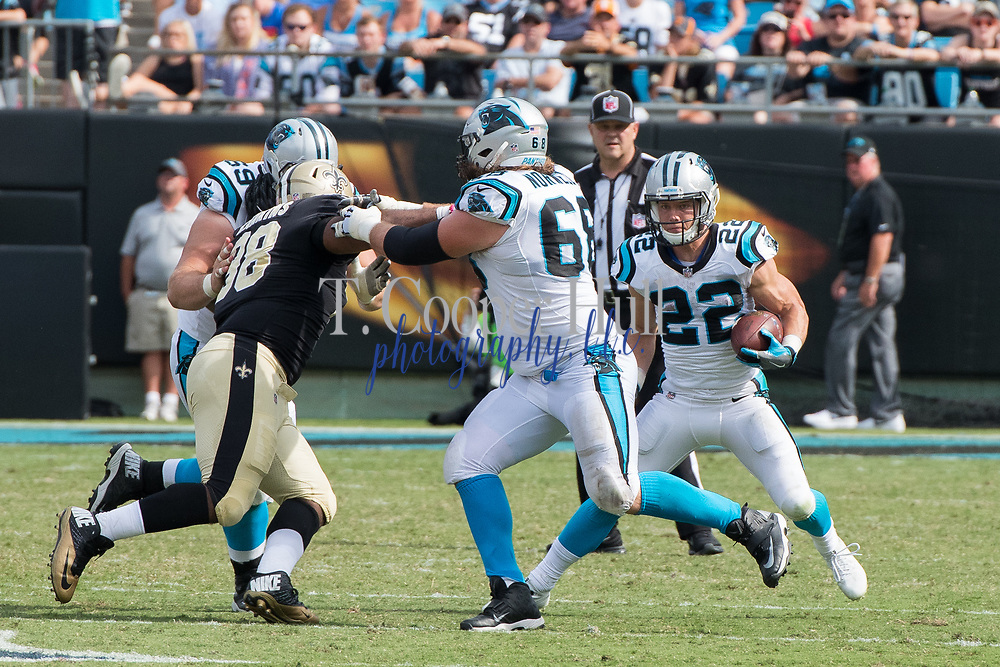Andrew Norwell(68) blocks Sheldon Rankins(98) for Christian McCaffrey(22) in the New Orleans Saints 34 to 13 victory over the Carolina Panthers.