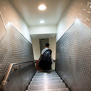 June 13, 2015 - New York, NY : A Ouest employee carries the garbage out on Saturday night, after the restaurant closed its kitchen for the last time. After more than a decade of service, Ouest, the Upper West Side restaurant and bar, served its last meal on Saturday night.  CREDIT: Karsten Moran for The New York Times