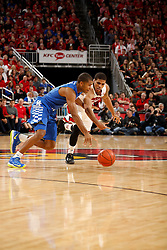 Kentucky guard Aaron Harrison, left, fights to maintain control of the ball with Louisville guard/forward Wayne Blackshear in the second half. Kentucky won 58-50.<br /> <br /> The University of Louisville hosted the University of Kentucky, Saturday, Dec. 27, 2014 at Yum Center in Louisville. <br /> <br /> Photo by Jonathan Palmer