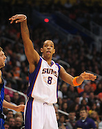 Feb. 17, 2011; Phoenix, AZ, USA; Phoenix Suns forward Channing Frye (8) reacts after putting up a basket against the Dallas Mavericks at the US Airways Center. Mandatory Credit: Jennifer Stewart-US PRESSWIRE