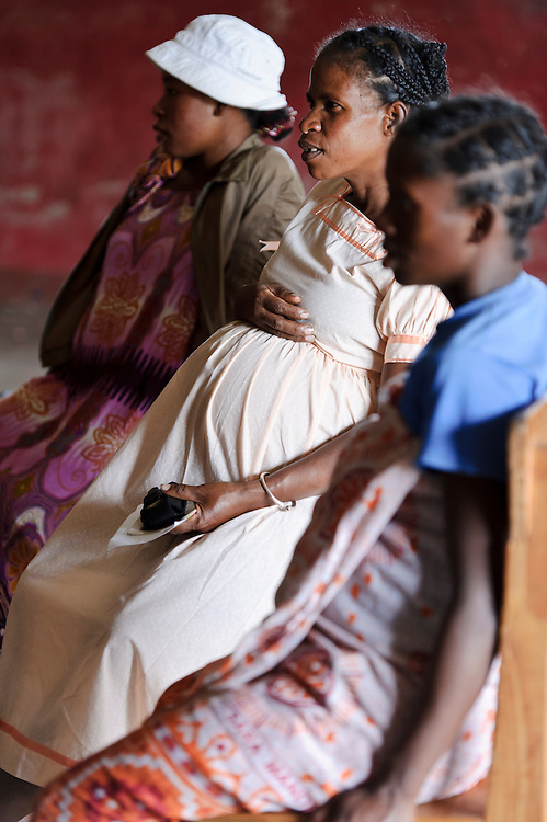 Pregnant women at an antenatal class run by Azafady, Ambanatao, Fort Dauphin, Madagascar. Azafady's mission is to alleviate extreme poverty and protect endangered, biologically rich forest environments in Madagascar by empowering some of the poorest people to establish sustainable livelihoods and improve their health and wellbeing. Their aims are to raise awareness about the plight of the Madagascan environment and the Malagasy people; to empower Malagasy people to improve their own lives; and provide support to communities and threatened environments. Azafady's approach is one of co-operation and participation with grassroots communities working to alleviate the effects of poverty and to support viable, environmentally sensitive development. Their holistic development and conservation projects support some of the world's most vulnerable people in threatened & irreplaceable environments. At the heart of the charity's work is an integrated approach to the needs of the Malagasy people and their unique environment, sensitively built around what local people have told the charity are their most critical needs and which maximises community participation. Azafady develop projects using the Sustainable Livelihoods model for poverty reduction, which aims to reduce vulnerability by strengthening communities' human, natural, financial, social and physical assets with a caveat that the charity's projects and activities do not compromise the environment. Projects incorporate communication, training and support at the level of the Fokontany (village) and the household, with a priority for the most isolated and marginalised communities. The charity has recently recruited a Research, Monitoring and Evaluation Manager, who will implement Azafady's new HIV/AIDS activities with pregnant and married women, with the aim of reducing rates of maternal transmission of HIV within the town.