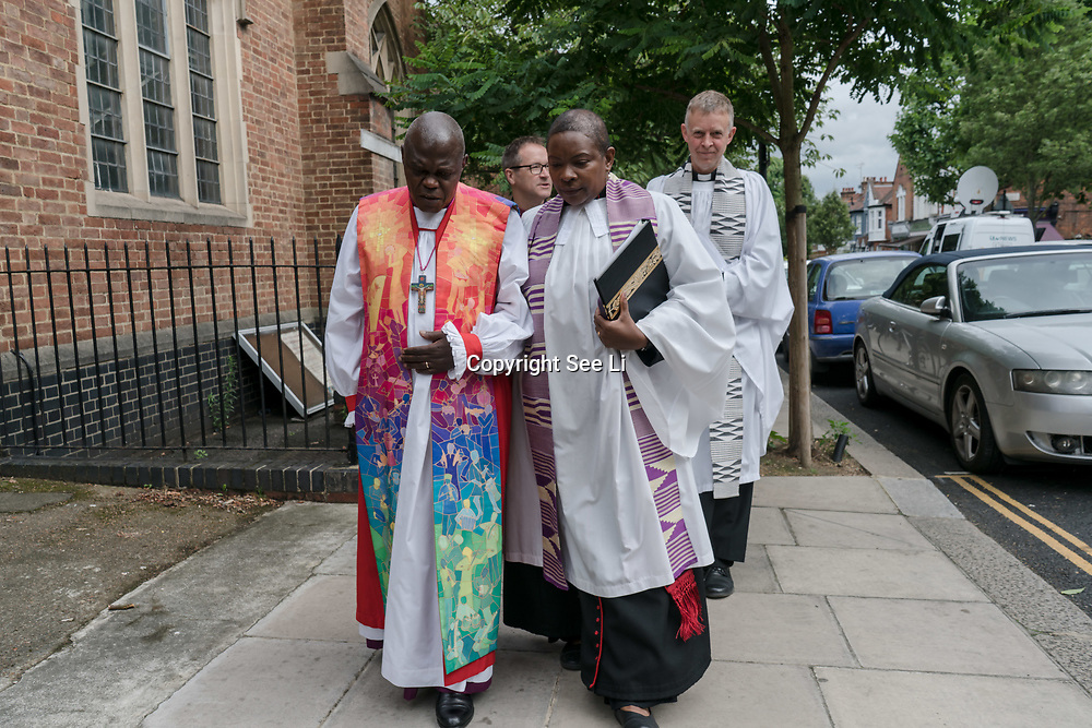 London, England, UK. 27th July 2017. Archbishop of York, John Sentamu living the memorial for The Late Mary Mendy, Khadija Saye, Berkti Haftom, Beruk Haftom, and Isaac (Welde Mariam) Grenfell Tower victims St Helen Church, North Kensington.