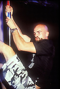 Manumission owner, Mike, clinging to a pole, Ibiza 1998