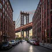 New York, United States of America - November 18, 2016: Pillar of Manhattan Bridge as seen from an alley in Dumbo district in Brooklyn