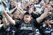 A Hull FC fan celebrates  during the Betfred Super League match between Hull FC and Hull Kingston Rovers at Kingston Communications Stadium, Hull, United Kingdom on 19 April 2019.