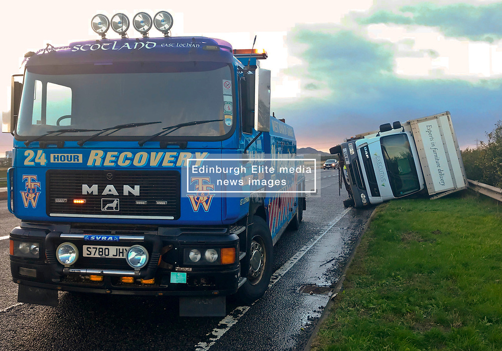 Pictured: <br /> Rescue was on hand the the high-sided delivery lorry on the A1 tonight.  The lorry was blown over on the A1 on the slip road down to join the Edinburgh City Bypass. Police and resuce services will be on high alert as Storm Ali moves across the country.<br /> <br /> <br /> Chris McCluskie| EEm 19 September 2018