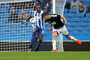 Brentford defender John Egan (14) heads the ball during the EFL Sky Bet Championship match between Brighton and Hove Albion and Brentford at the American Express Community Stadium, Brighton and Hove, England on 10 September 2016.