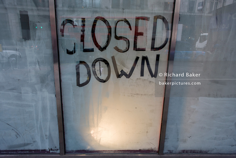 Closed Down is written on a paint-covered window of a generic business in Central London, a victim of the UK recession.