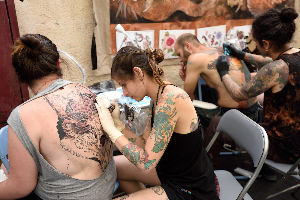 TEL-AVIV, ISRAEL - June 06, 2015: Israelis get their body tattooed during the 3rd annual tattoo convention in Tel-Aviv on June 6, 2015.The Convention hosted Israeli and international tattoo and piercing artisits. Photo by Gili Yaari