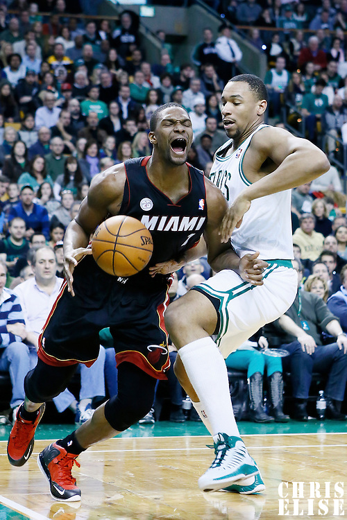 27 January 2013: Miami Heat center Chris Bosh (1) is fouled by Boston Celtics power forward Jared Sullinger (7) during the Boston Celtics 100-98  2OT victory over the Miami Heat at the TD Garden, Boston, Massachusetts, USA.