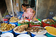 Hom Market. Food stall with fried fish, shrimps and pork.