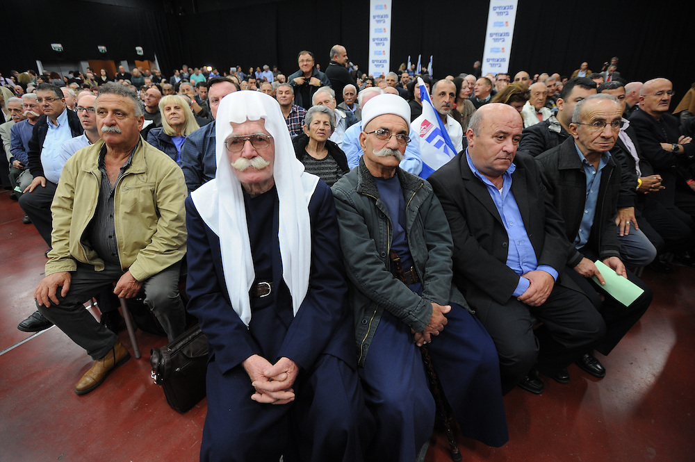 "Druze members of the Labor party vote in favor of the unite with the ""Tnua"" party, lead by Tzipi Livni, at the Labor Party conference in Tel Aviv on December 14, 2014. The Labor Party conference approved on Sunday evening the details of the deal to set up a centrist block with Tzipi Livni's Hatnuah. Photo by Gili Yaari"