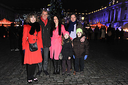SIR PAUL & LADY SMITH her son JASON DENYER, his wife STEPHANIE and their daughters POPPY DENYER (Red hat) and ZANY DENYER (yellow hat) at Skate presented by Tiffany & Co at Somerset House, London on 22nd November 2010.