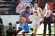 "Florida's Casey Prather (24) vs. Mississippi's Anthony Perez (13) at the C.M. ""Tad"" Smith Coliseum in Oxford, Miss. on Saturday, February 22, 2014. Florida won 75-71.  (AP Photo/Oxford Eagle, Bruce Newman)"