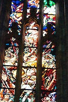 Milan, Italy, Duomo Cathedral. Stained glass window. Panes depicting the fight between good and evil?